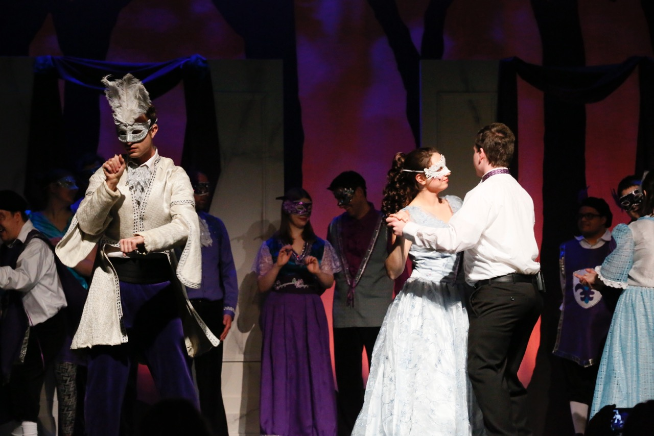 Masked Prince Topher signs ; his Voice dances with masked Cinderella