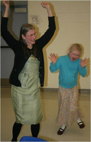 Mother and daughter do the hokey pokey